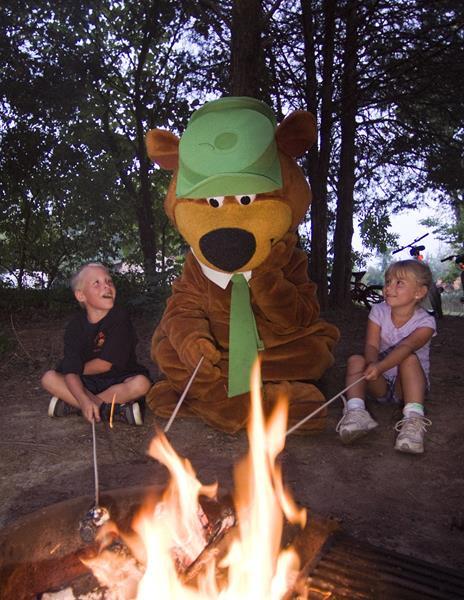 Kids and Yogi Bear at campfire
