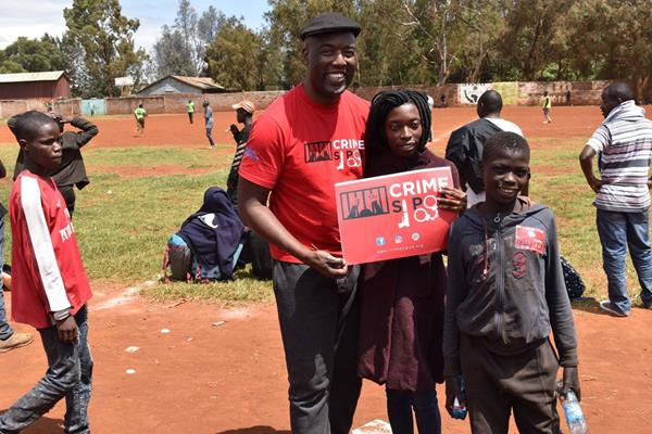 Youth Safety Awareness Initiative's Executive Director Peter Ouko with children participating in a Youth Safety Awareness Initiative program. © Youth Safety Awareness Initiative