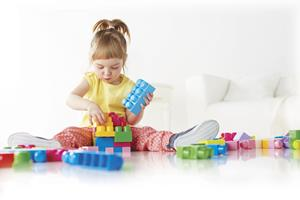 Little Girl playing with Megs blocks