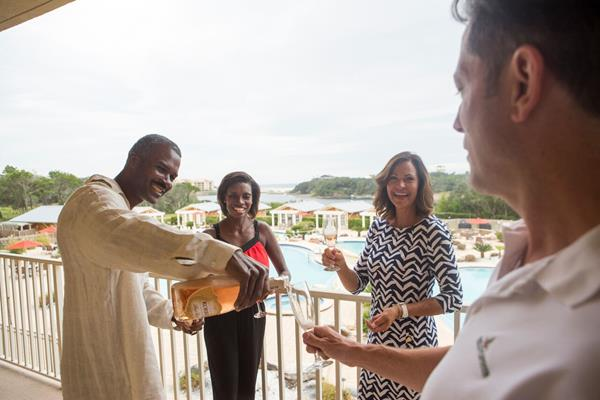 Friends celebrate New Year's Eve in a vacation rental home at Sanctuary at Redfish Resort in Blue Mountain Beach along Hwy 30-A.