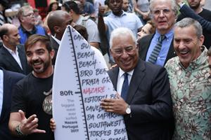 Portugal Prime Minister in Times Square with Guinness Book of World Record Surfers Rodrigo Koxa and Garrett McNamara.