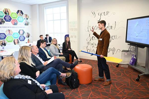 Students in High Point University's Entrepreneurship Club pitched their business ideas to Randolph inside Cottrell Hall's Graves Collaboratorium and Belk Center for Entrepreneurship.