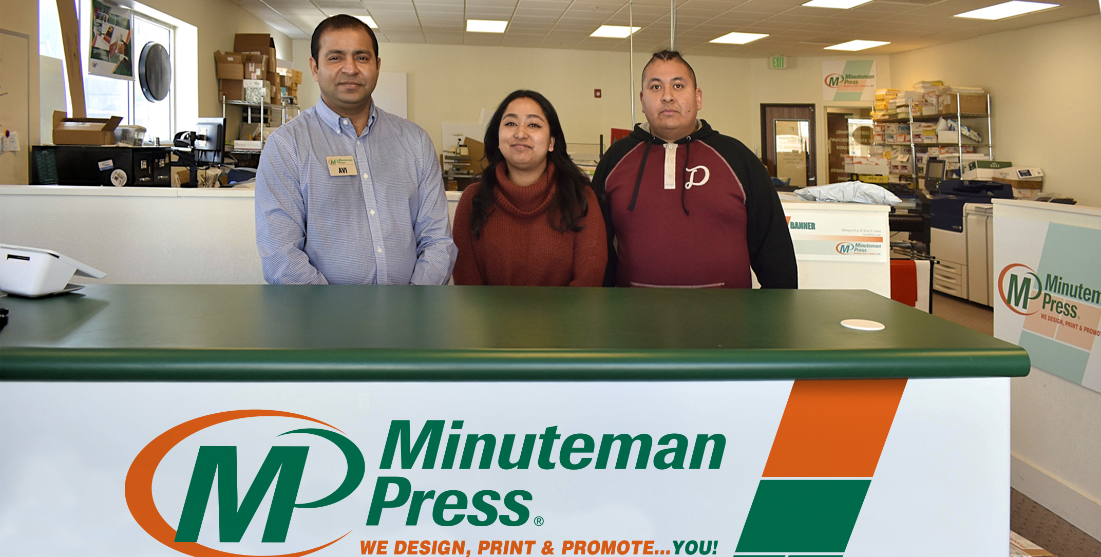 Avi Kumar (left) owns the Minuteman Press design, marketing, and printing franchise in Greeley, Colorado.