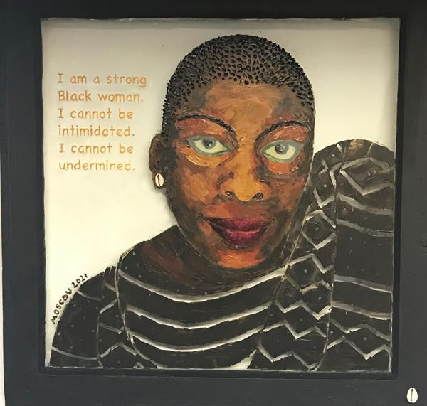"""Strong Black Woman #1 is a mixed media work by artist Kathy Moscou (wood, glass, oil and cowrie shell). Size: 24"""" x 24"""""""
