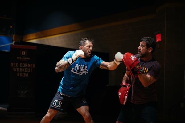 MMA Champion Ryan Bader prepares for a match wearing a Kill Cliff shirt