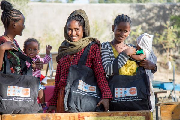 Conflict-affected women with their UNFPA Dignity Kits at Meserete IDP camp in Mekelle, Tigray. Photo by © UNFPA Ethiopia - Paula Seijo.