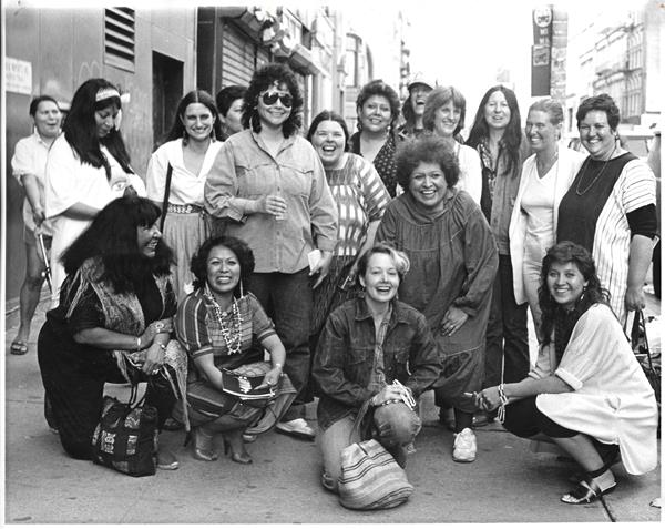 "From the exhibition, ""Women of Sweetgrass, Cedar and Sage,"" friends and community members outside the American Indian Community House Gallery, 1985. Photo by Jesse Cooday."