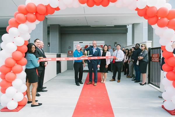 Chino Hills Mayor Peter Rogers, General Manager Brandon Jemison and Director of Sales Donna Soumphonphakdy cut the ribbon to officially open the TownePlace Suites by Marriott Ontario Chino Hills California