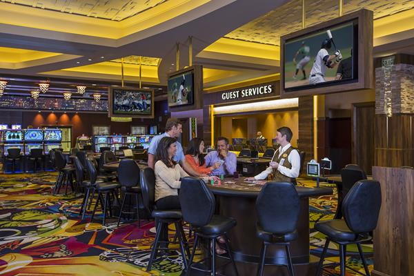 """If you are interested in a career as a table games dealer, we are also offering free Dealer School. If you successfully complete the course, you are guaranteed a job with Monarch Casino Resort Spa. Text """"MONARCH"""" to 97211 or go to jobs.monarchblackhawk.com for more information."""