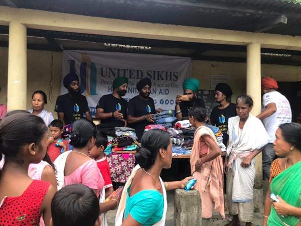 UNITED SIKHS Volunteers Distribute Clothing to Assam Flood Survivors