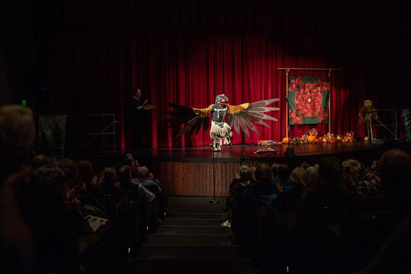 """Gene Tagaban, a Native American Storyteller, performs """"The Raven Story"""" at the 2019 Forest Storytelling Festival in Port Angeles, Washington"""