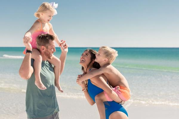 Families enjoy reconnecting during a spring beach getaway to Destin, Florida.