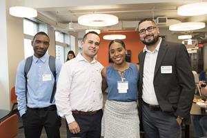 The welcome reception for the second cohort of the NYU Cyber Fellows gave executives and students opportunities to discuss internship and career opportunities. Left to right: Cyber Fellows Christopher Desir, Fabian Moreno and Jefferson Baracaldo, with JP Morgan Chase Senior Recruiter Erica Chacon (center)  Credit: NYU Tandon: Elena Olivo