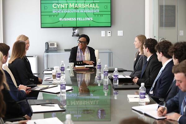 Cynt Marshall (center), CEO of Mark Cuban's NBA team the Dallas Mavericks and HPU's Sports Executive in Residence, met with High Point University Business Fellow students to share tips on how to assess and develop culture.