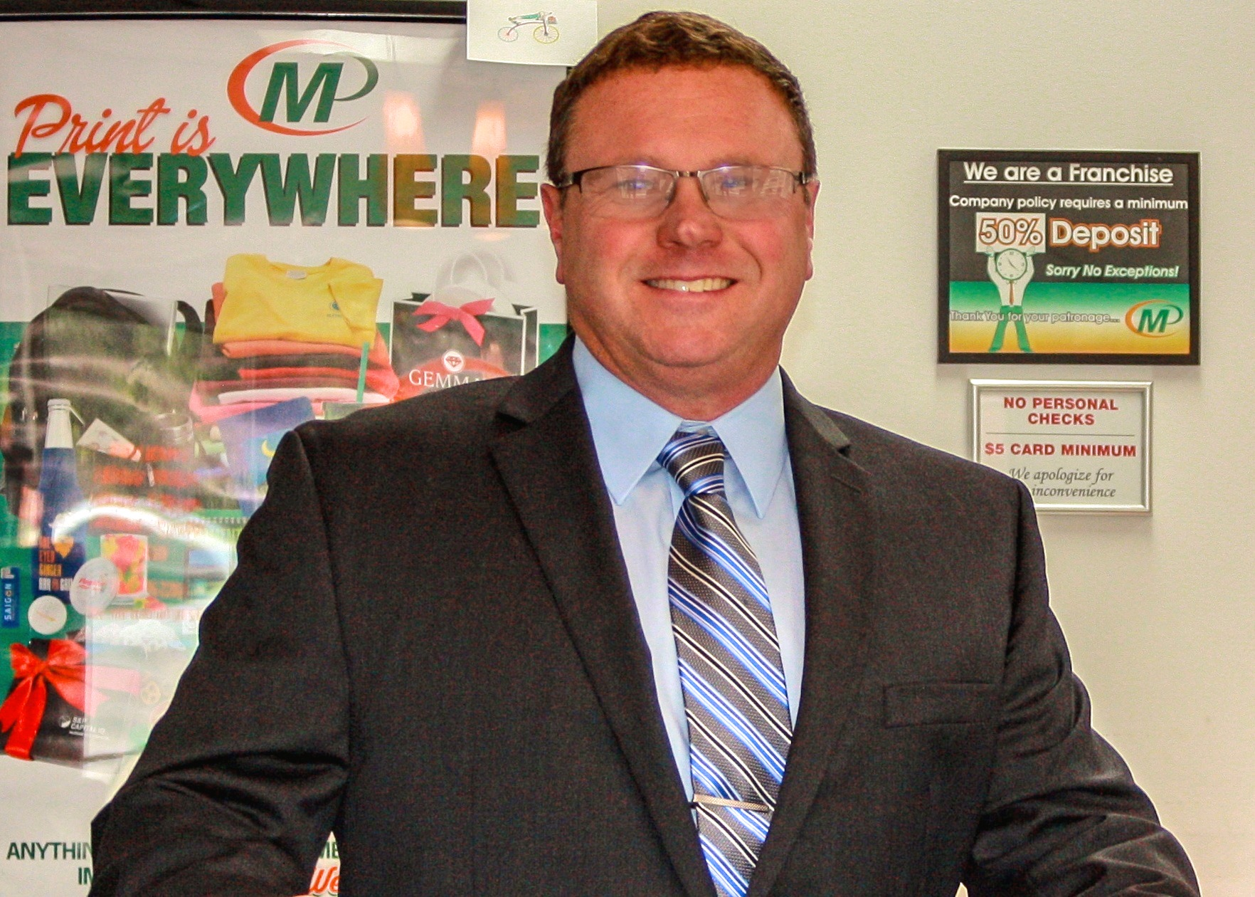 United States Marine Corps Veteran David Farmer owns the Minuteman Press franchise in Chester, VA.