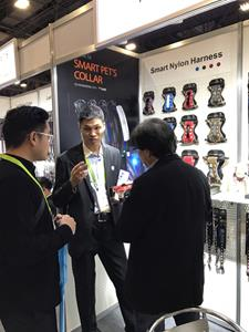 Staff demonstrating the Dogness H2 Smart Harness at CES 2018