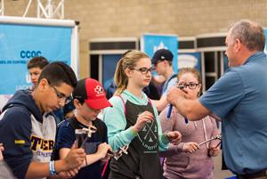Student visitors participate in a Try-A-Tradeâ and Technology activity at the 2018 Skills Canada National Competition, in Edmonton.