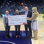 Mountain America presents a $11,250 check to Adam Whitaker and Jennifer Bean, who represented the American Red Cross, at the BYU game on March 2, 2019.
