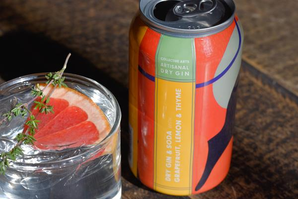 Dry Gin & Soda with Grapefruit, Lemon & Thyme. Garnished with grapefruit and thyme.