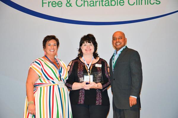 NAFC President & CEO Nicole Lamoureux, RWJF-NAFC Award for Health Equity Winner Angela Settle and NAFC Board Chair Dr. Bobby Kapur at the NAFC 2018 Symposium Awards Lunch