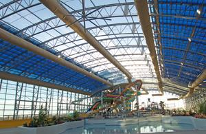 The largest indoor water park under a single curved  retractable roof in the USA.