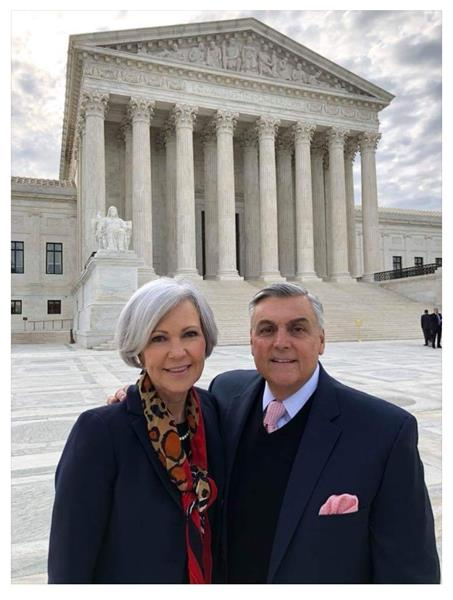 Raymond Lucia and his wife, Jeannie stand outside of the US Supreme Court in Washington, DC shortly after winning their case. (NCLA)