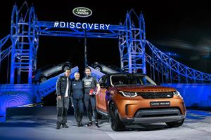 Bear Grylls, Zara Phillips and Sir Ben Ainslie pose by the new Land Rover Discovery in front of a world record-breaking LEGO Tower Bridge structure.jpg