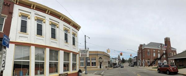 A panoramic view of the heart of the Village of Cedarville, Ohio. The historic Cedarville Hardware has been in business since 1952, but it will close its doors for good on May 19. Cedar Care LLC purchased the building and will renovate it into a pharmacy that will serve the rural population. At right is the historic opera house. (Photo by Mark D. Weinstein)