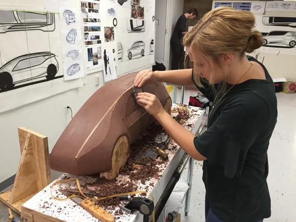 Kelly Miller from Cedarville University's Industrial and Innovative Design program uses clay to design as prototype of a Chevrolet 2+2 battery electric car. (Photo by Scott Huck, Cedarville University)