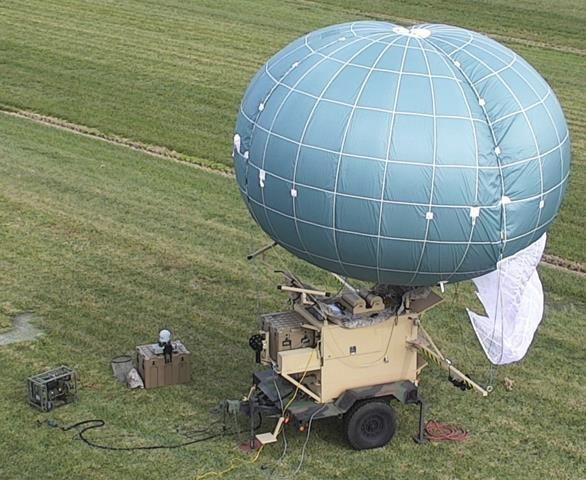 """Drone Aviation's Winch Aerostat Small Platform (""""WASP"""") is a highly tactical and mobile aerostat system which can be operated by as few as two soldiers and can provide day/night video, secure multi-frequency and multi-wave form wireless communication range extension capability at the edge of the battlefield from either a stationary position or while being towed."""