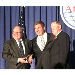 Bob Chisholm receives award from AFCEA International.