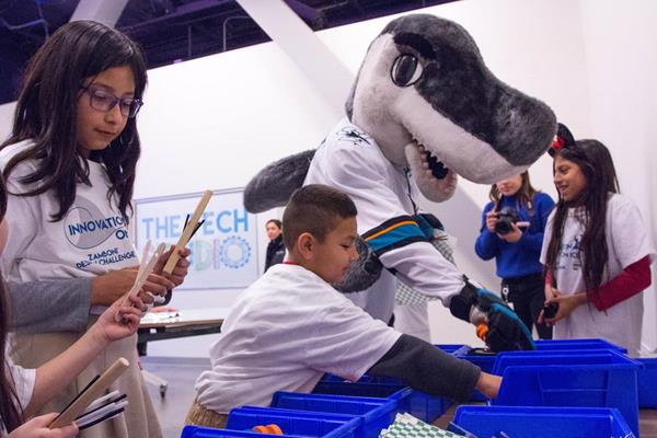 Sharkie and students select materials to build a wind-powered ice resurfacer as part of the Innovation on Ice partnership with The Tech Museum of Innovation, Sharks Foundation and SAP. Innovation on Ice: Code Teal will allow students to learn coding in an ice hockey-themed STEM activity. (San Jose, CA)