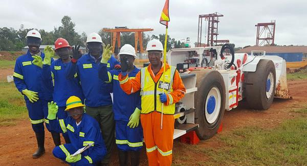 Trainee operators from the local Mokopane community with Platreef's new  5.5-tonne, load-haul-dump machine (LHD).
