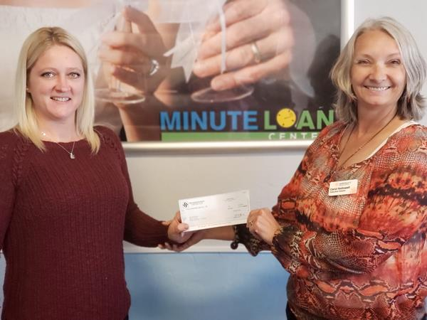 Contribution Image Caption:    Minute Loan Center, St. George, Utah makes a contribution to Switchpoint Center to help serve people in crisis.  This is part of Minute Loan Center's Extra Mile community program where each a different store will make a donation to a charity or resource they select.  This is Alesha Arviso, Store Manager presenting Carol Hollowell, Switchpoint's Executive Director.    Minute Loan Center | https://www.minuteloancenter.com/locations/?id=st-george