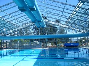 Retractable roofs are affordable for communities of all sizes for Indoor pool with retractable roof