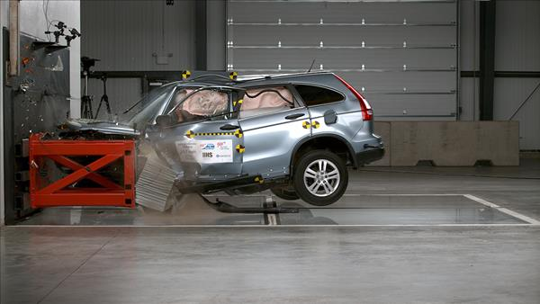 Action shot taken during the 56-mph moderate overlap frontal crash test. The vehicle's interior was significantly compromised in this test.