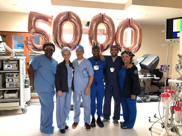 Dr. Geoffrey Schnider (third from left) celebrates the 5,000th gynecologic robotic surgery with surgical staff at The Woman's Hospital of Texas.
