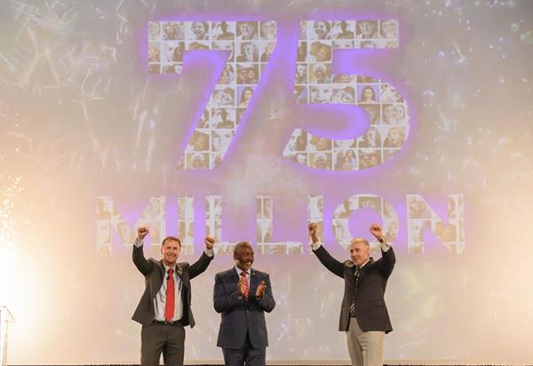 (Left to right) Adrian Jones, Visit Orlando Board Chair and Divisional Director USA, Merlin Entertainments USA Inc.; Orange County Mayor Jerry L. Demings; and George Aguel, President and CEO, Visit Orlando; celebrate a record 75 million visitors to Orlando in 2018.