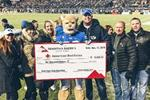 Mountain America employees present a $6,000 check to Adam Whitaker, who represented the American Red Cross, at the BYU game on November 17, 2018.