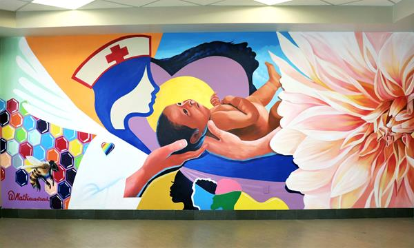 Mathieu Jean Baptiste's mural pays homage to the colleagues of The Woman's Hospital of Texas, who are continuing to provide care during the pandemic. Every aspect of the mural symbolizes different aspects of the hospital.