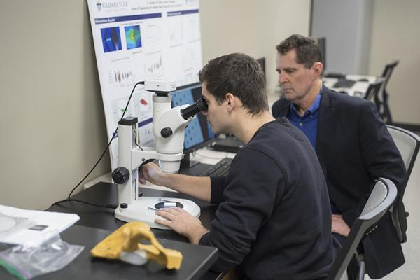 Mitchell Ryan studies human tissue scaffolds in a Cedarville University laboratory with Dr. Tim Norman, professor of mechanical and biomedical engineering. (Photo by Scott Huck)