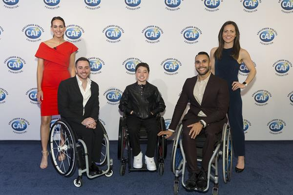 (Left to Right). SF 49ers host Laura Britt poses with Steve Serio, Team USA's Mens Wheelchair Basketball Co-Captian,  Devan Watkins, 12-year-old CAF Grantee from Menlo Park, Jorge Sanchez, Team USA Wheelchair Basketball player and Therese Viñal, SF Giants sportscaster.