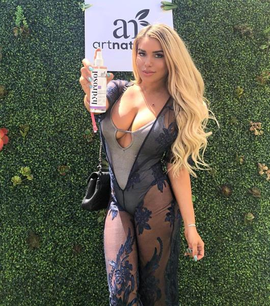 Chantel Zales loving the Art Naturals Rose Hydrosol Spray at the GBK and Art Naturals Influencer and Celebrity Gifting Lounge at Miramonte Resort during Coachella Weekend One.