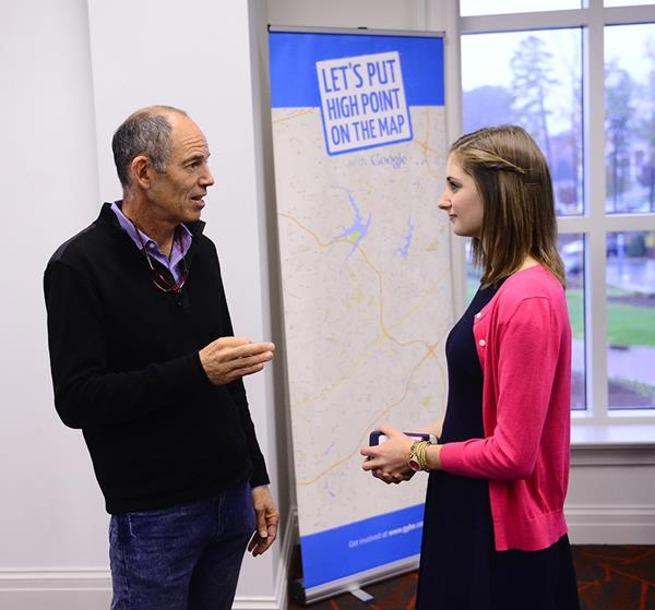 HPU student Mandy Engelman, right, pitched her business plan to Randolph inside HPU's Entrepreneurship Center.
