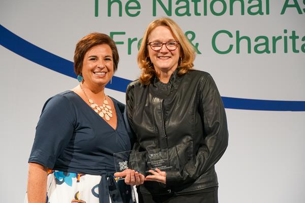 Nicole Lamoureux, NAFC President and Chief Executive Officer presents Eileen Howard Boone, Senior Vice President of Corporate Social Responsibility and Philanthropy for CVS Health and President of the CVS Health Foundation with the NAFC 2019 Safety Net Health Care Champion Award.