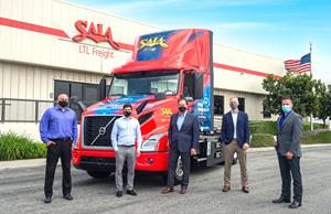 Saia LTL Freight recently took delivery of two Volvo VNR Electric trucks at its terminal in Los Angeles, California. Saia representatives pictured from left to right include Kevin Szydel, vice president of operations, west; Patrick Sugar, executive vice president of operations; Fritz Holzgrefe, president and chief executive officer; Cris Burgum, vice president of maintenance and properties; and Brandon Bruton, director of maintenance and administration.