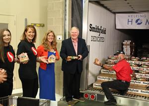 Representatives from Safeway, Oregon Food Bank and Smithfield unload a portion of Smithfield's 25,000lb Protein Donation