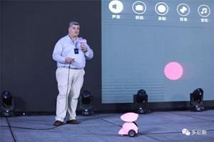 Mr. George Taylor, Sales & Marketing Director, demonstrates the Dogness Smart iPet Robot on stage at the product launch event