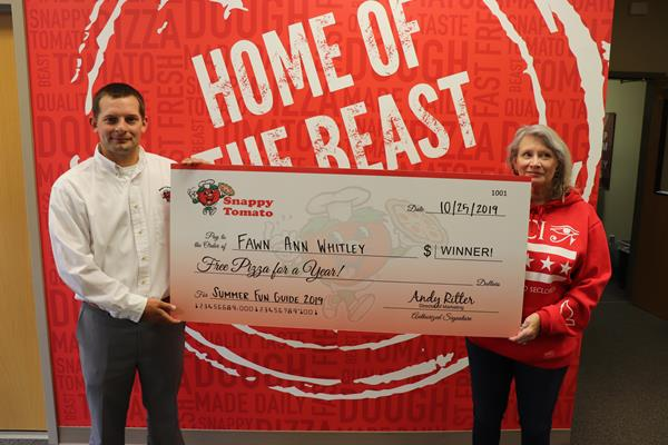 Fawn A Whitley Winner Image: Snappy Tomato Pizza Family Fun Guide 2019 free Snappy Tomato pizza for a year winner is Fawn A. Whitley of Cynthiana, Kentucky. Pictured with Ms. Whitley is Andy Ritter, Director of Marketing for Snappy Tomato Pizza Company - www.SnappyTomato.com #Winner #Pizza #SnappySummer