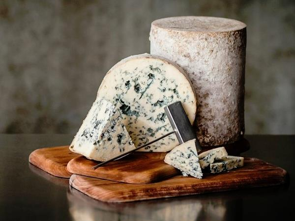Bayley Hazen Blue, a raw-milk, natural rind blue with a semi-firm texture that becomes creamy on the palate, with notes of sweet cream, toasted nuts, and subtle anise spice.